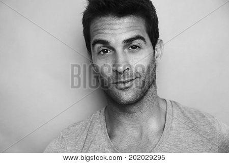 Handsome dude in black and white portrait studio