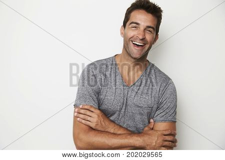Handsome Laughing guy in grey t-shirt portrait