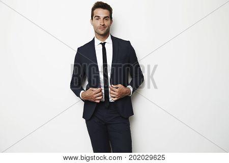 Portrait of sharp dressed dude in suit smiling