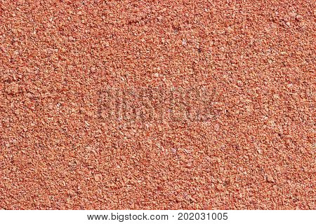 Red finely ground pepper scattered with an even horizontal layer