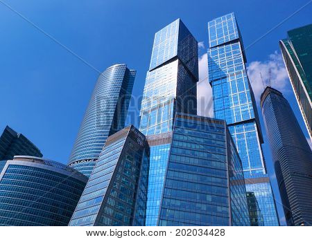 Bottom view on business buildings offices of Moscow-City business center. New modern Moscow financial business architecture. Triangle geometry architecture. Famous Moscow sightseeing points tours.