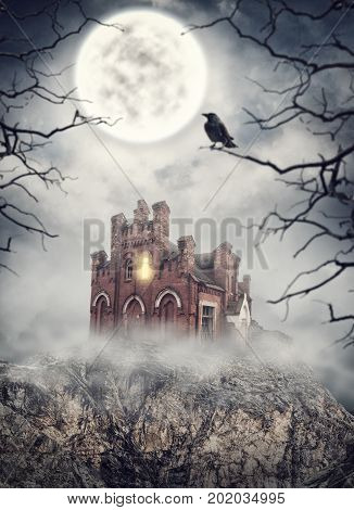 Haunted abandoned house on the rock in night. Halloween scene