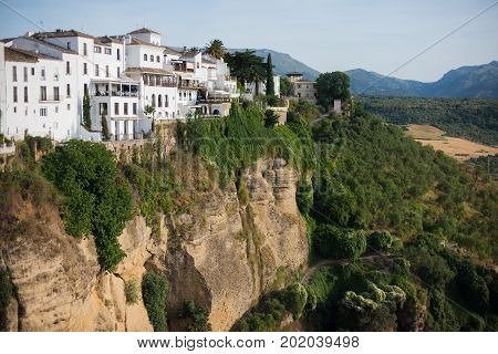 Ronda town belongs to Andalusia is on the cliff. Beautiful cityscape with mountains.
