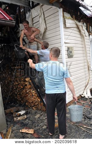 NAHIRYANKA - CHORTKIV - Ukraine - May 31 2016. The elimination of the fire building which engulfed two houses except for emergency services rushed to help neighbors and villagers.