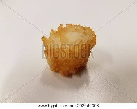 a tater tot with bite taken out of it
