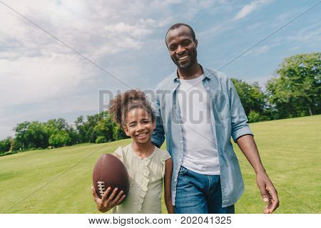 African American Family With Rugby Ball