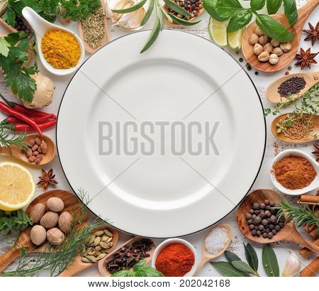 Herbs and Spice Collection with Empty Plate,Top View.