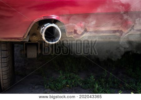 White Smoke From The Exhaust Pipe Of The Car.