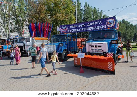 Donetsk Ukraine - August 27 2017 - Townspeople visiting an exhibition of communal equipment on Lenin Square on City Day