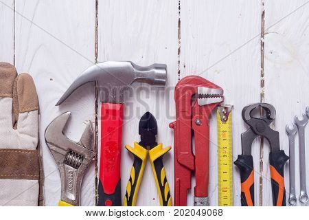 Set of tools on wooden background . Top view with space for text