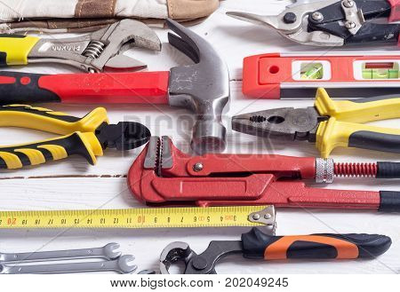 Set of tools on wooden background .
