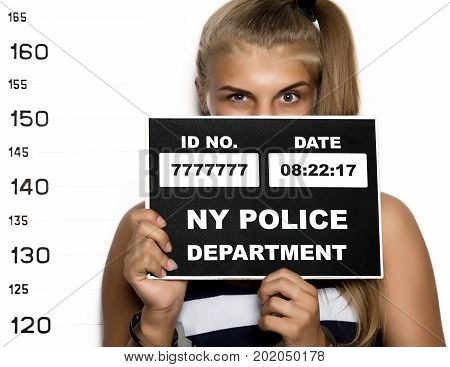 Young beautiful blonde woman Criminal Mug Shots.