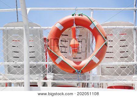 Life buoy hanging on modern boat