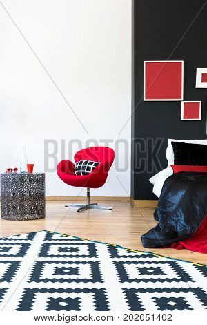 Sophisticated Bedroom With Red Furniture