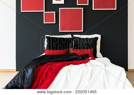 Black Wall With Red Posters