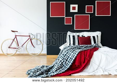 Red Bike Against White Wall