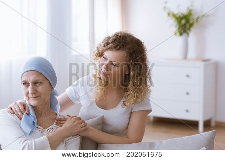 Daughter Supporting Mother After Chemotherapy