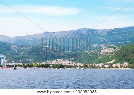 Picturesque view of small city on seashore