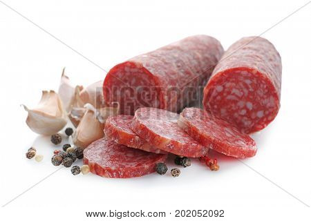 Delicious sliced sausage with garlic and peppers on white background