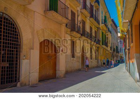 PALMA DE MALLORCA, SPAIN - AUGUST 18 2017: Unidentified people walking in the streets in old city of Palma de Mallorca, Spain.