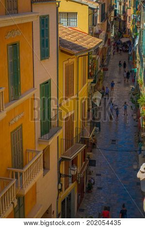 PALMA DE MALLORCA, SPAIN - AUGUST 18 2017: Aerial view of unidentified people walking in the streets in old city of Palma de Mallorca, Spain.