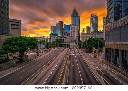 Road to modern office buildings in central Hong Kong . Central Business District in Hongkong city at sunrise .