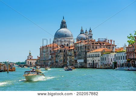 Venice, Italy - May 18, 2017: Grand Canal with Basilica di Santa Maria della Salute. Grand Canal is one of the major water-traffic corridors in Venice.