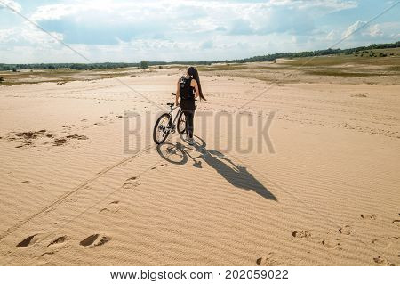 Happy Gilr Going Outdoor At The Sunset Time. Concept Of Sport, Bicycle Tourist Stand Desert