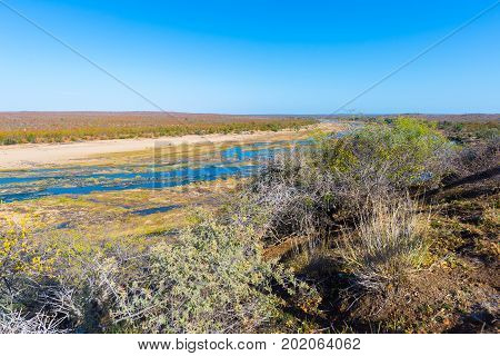 Olifants River, Scenic And Colorful Landscape With Wildlife In The Kruger National Park, Famous Trav