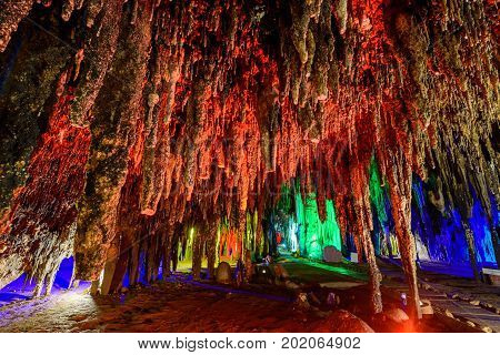 Stalactite stalactites with color lighting in cave