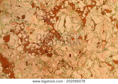 Abstract marble effect. Mixed red yellow and green colors. Unusual background for poster book card invitation texture.