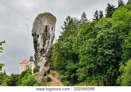 Beautiful antique rock and historic castle. Hercules Mace and castle in Pieskowa Skala in Poland.