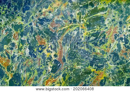 Abstract marble effect on stone. Mixed yellow blue and green colors. Unusual background for poster book card invitation texture.