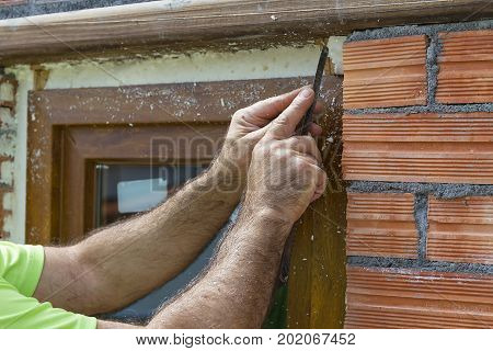 A man working in a wall construction