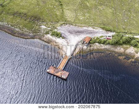Aerial of the rotten old pier on the shore of Loch Etive, Scotland