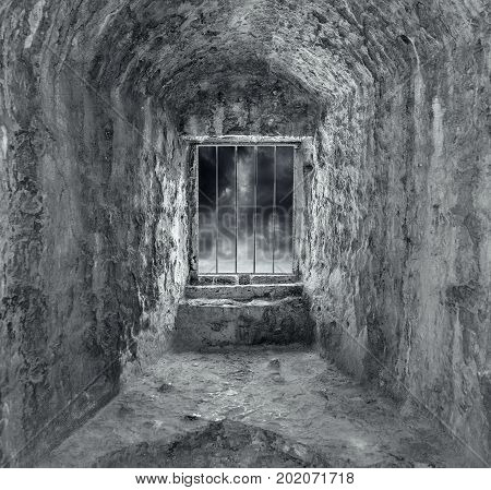 Stone dungeon with window and bars. Dark tones.