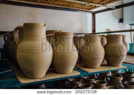 Drying after molding unbaked pottery in workshop.