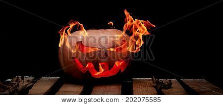 A Very Dangerous Dangerous Halloween Pumpkin, With A Stern Gaze And A Smirk Of A Villain, In The Dar