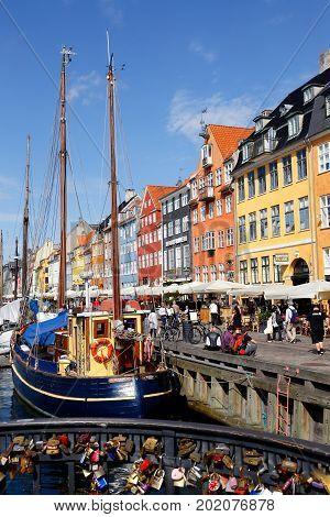 Copenhagen Denmark - August 24 2017: View of Nyhavn from the bridge Nyahvsbroen.