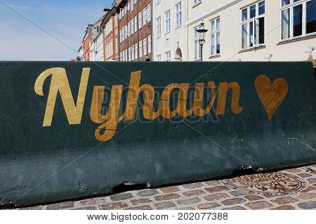 Copenhagen Denmark - August 26 2017: One green concrete barrier with NYhavn logo including a heart symbol.
