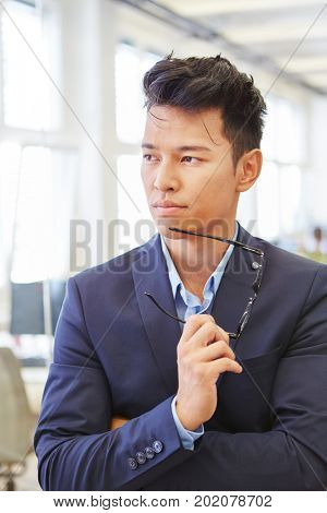 Young businessman as manager thinking about decision