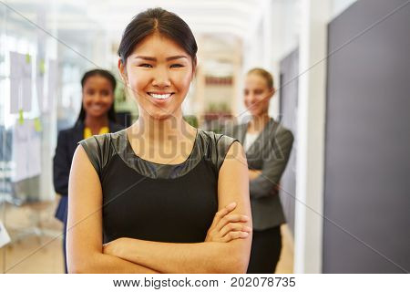 Young woman as trainee with her successful business team