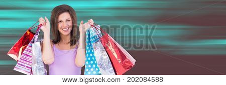 Digital composite of Shopper holding up bags against blurry teal and red background