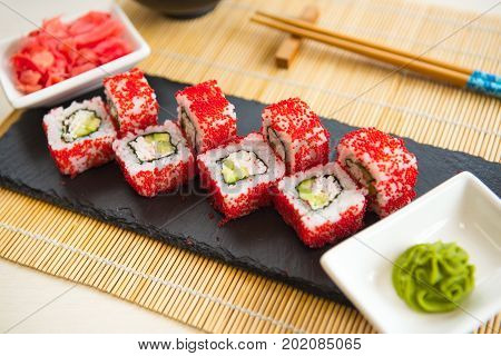Sushi Roll With Salmon. Sushi Rolls On Black Slate Surface. Japanese Food