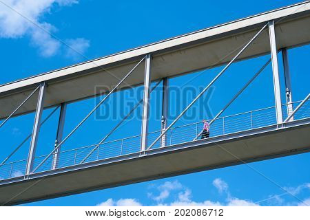 BERLIN, GERMANY - AUGUST 07, 2017: Man on a bridge between two government buildings in the government quarter in Berlin