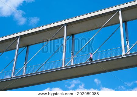 Man on a bridge between two government buildings in the government quarter in Berlin