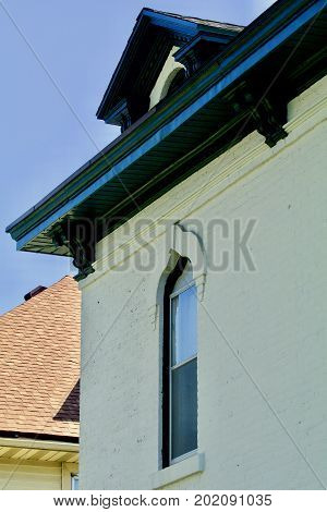 Nineteenth century white brick house with green trim facade