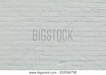Rows of brick painted white as a background