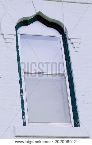 Nineteenth century white brick house fancy window