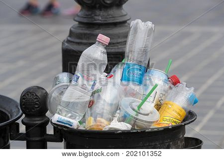 BUDAPEST, HUNGARY - 19 AUGUST 2017: Street trash cans are filled with garbage cans with plastic bottles of scans up to the top.